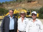 John Mahoney from Komatsu, Brad Starr and Dave Reddiex from Montrose Mining with the company's new hybrid excavators. Photo Michelle Gately / Morning Bulletin