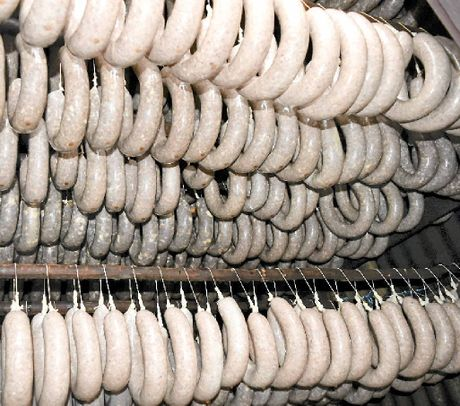 MEAT AND GREET: 600 wurst sausages are smoked so three families can enjoy them all year.