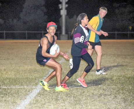 TOUCH FOOTY: Kelvin Cooper calls the shots in a weaving run last Monday night.