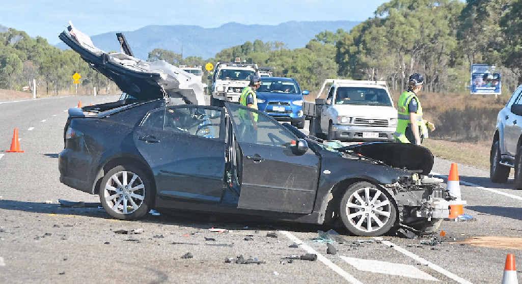 MAYHEM: Police direct traffic around the ruined sedan. Photos: Eve Reitmajer / Bowen Independent