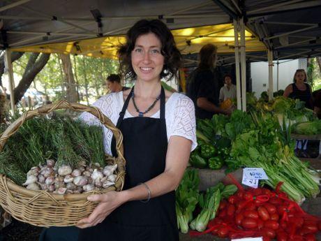 Jemma Hubbard of Shambhala Farm at Noosa farmers Market with her produce. Gail Forrer/ Noosa News.