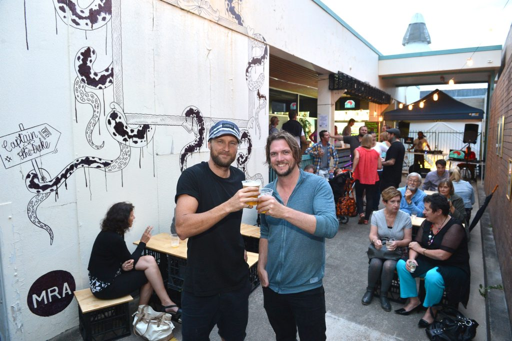 Brendan Bryant (hat) and James Birrell have a mobile bar at the' Nights on Ocean' markets, called Captain and the Duke. Photo: Warren Lynam / Sunshine Coast Daily