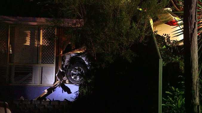 A couple were woken with a fright when a 4WD crashed through their bedroom wall in Korora.