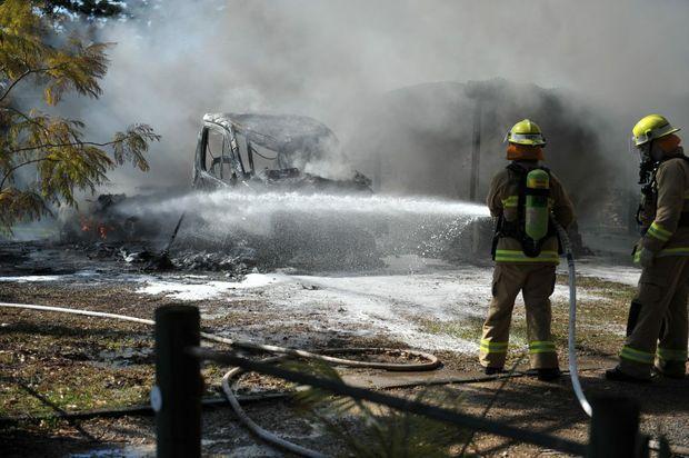 Fire crews battle a blaze on Archville Station Rd, Boambee on Thursday, July 30, 2015. Photo David Barwell / Coffs Coast Advocate