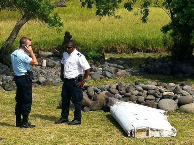 Police guard the unidentified plane wreckage.