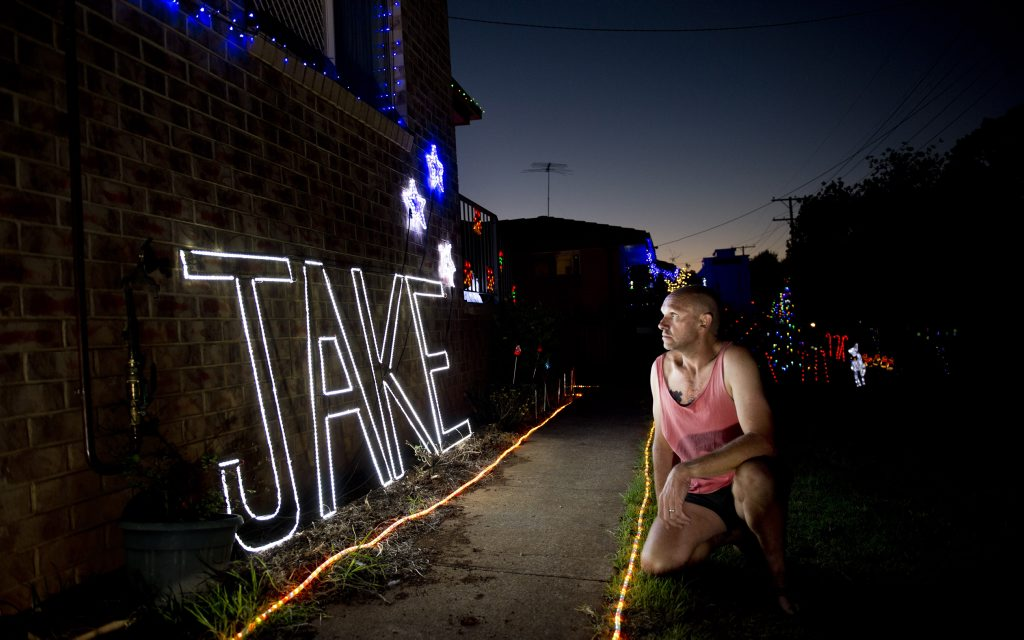 John Lasker looks at the sign made by a friend to remember his murdered son Jake Lasker. Photo Nev Madsen / The Chronicle