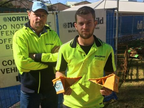 Site manager Mick Heaney (left) with carpenter Karl Bambosek holding all that's left after thieves broke into the construction site and stole his trailer and $8,000 worth of tools. Photo Rachael Murray / The Chronicle