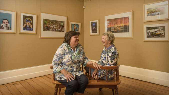 HELPING HANDS: Grafton Regional Gallery volunteers Joan Bruschett and Lyn Jarman enjoy a joke in the Prentice House gallery.