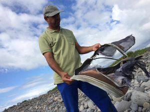 Suitcase found near suspected MH370 plane debris