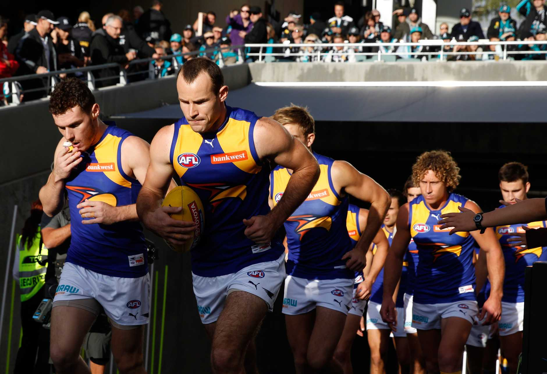 Shannon Hurn leads his team out.