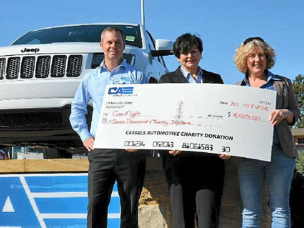 HELPING HAND: David Cassels and Linda Symon, from Cassels Automotive, present CareFlight representative Sarah Delahunty with a cheque for $7020, which was $30 from each vehicle sold by the dealership in the past 12 months.