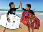 LIFE WITHOUT THE DICKY: Eight-year-old twins Aramis and Dante Tocantins ready to catch a wave at Dicky Beach.