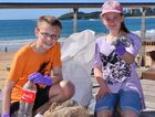 GREAT JOB, KIDS: Zachary and Ruth Copas make a difference at Mooloolaba yesterday during a Sunshine Coast beach clean-up event.