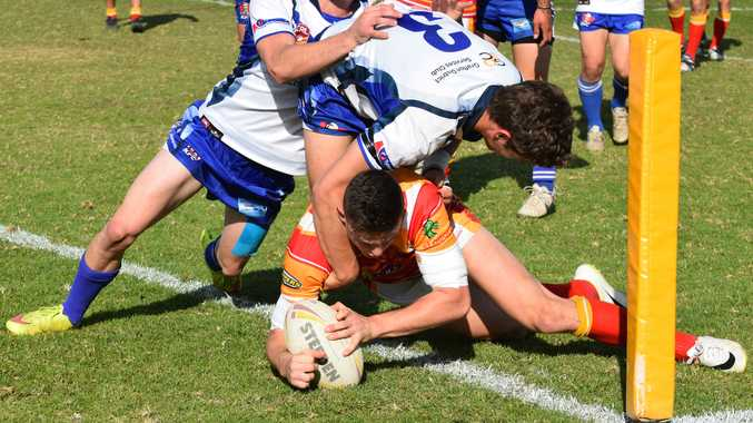 Billy Griffiths scores an early try for Coffs Harbour.