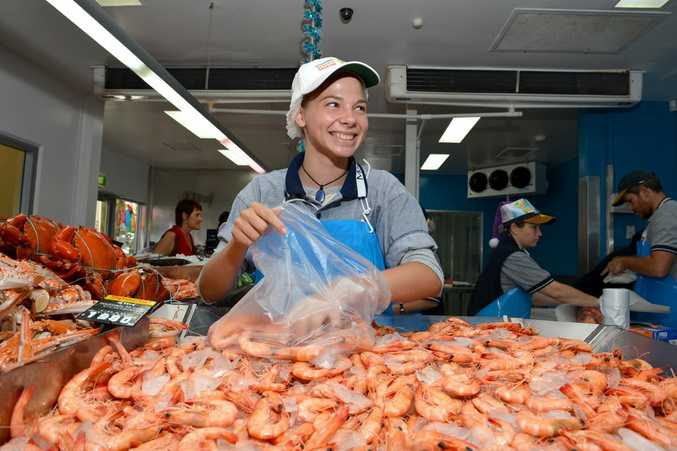 Christmas rush for prawns and seafood at Mooloolaba Fish Market. Tarlie Weller fills up a bag for customers. Photo:Warren Lynam / Sunshine Coast Daily