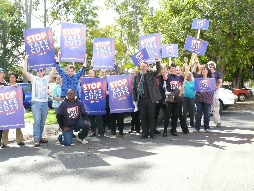Greens senator Dr John Kaye leads Grafton TAFE protesters at a rally in the city last August.