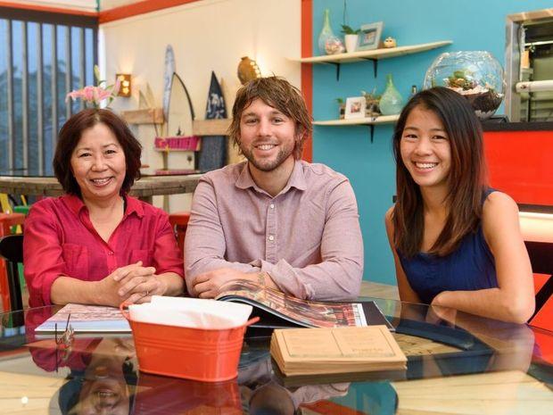 Restaurant Revolution contestants Maggie Yeong, John McIntosh and Justine Yeong inside their Brisbane restaurant Puerto.