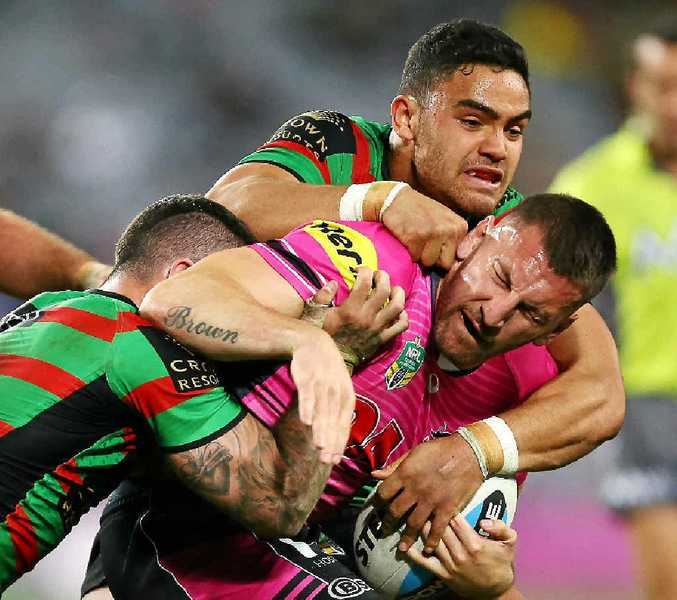 GOT HIM: Lewis Brown is tackled by the Rabbitohs.