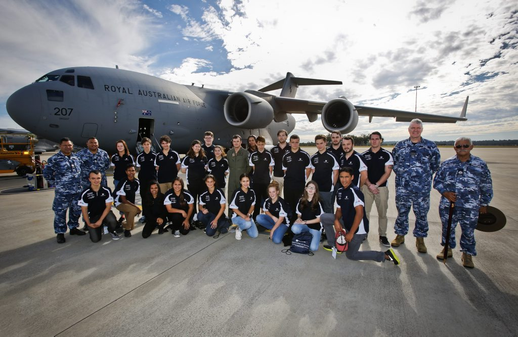 Students and Defence mentors on the No. 36 Squadron flight line with a C-17A Globemaster aircraft during their visit to RAAF Base Amberley. Photo Contributed