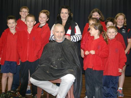 Showing off their shaving prowess are Bunker's Hill State School Year 6 students with School principal Mr Jim Tiernan and hairdresser Mrs Shandelle Trapp.