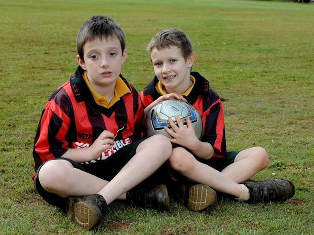 Shawn Rogers, 9, is legally blind, he plays soccer with Alstonville Cheetahs. The ball has bells in it so he can hear it. He scored a goal last weekend. Pictured here with his brother Rhyan Rogers, 7, who plays in the same team. Photo Mireille Merlet-Shaw / Northern Star