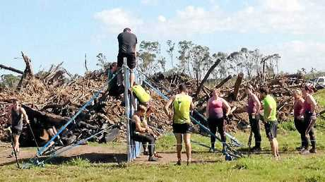 UP AND OVER: Participants face one of the challenges in the Obstacles Gone Mad event at Yeppoon on Saturday.