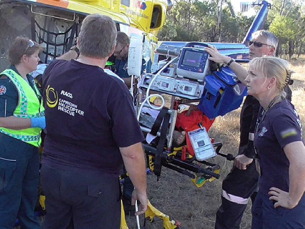 RACQ Capricorn Helicopter Rescue Service crews tend to Daphne Ralphs at the scene.