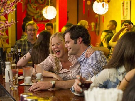 Bill Hader and Amy Schumer in Trainwreck.