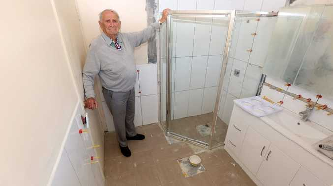 Ninety two year old Charles Tompson in his unfinished bathroom which was subject to dodgy workmanship and overcharging. Photo: Nolan Verheij-Full / Tweed Daily News