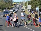 Parents and students cross Pine Mountain Road from Brassall State School. Photo: Rob Williams / The Queensland Times