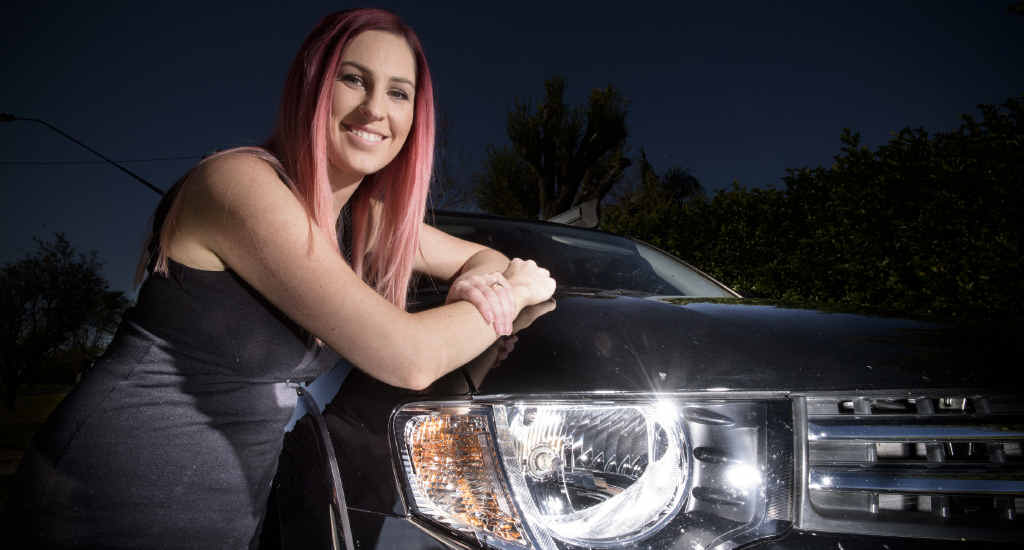 LIGHTS ON: Gemma Radin travels with her lights on during the day in her black Mitsubishi Triton. Photo Adam Hourigan