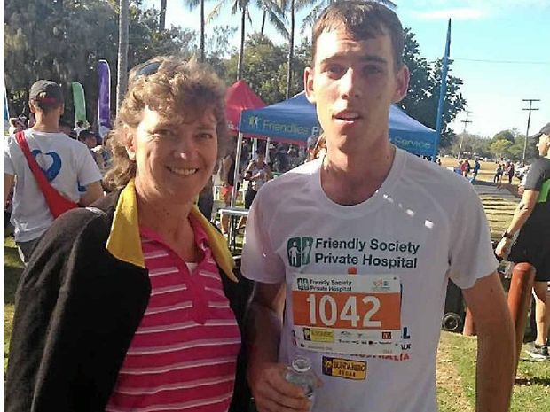 FAMILY SUPPORT: A proud Wendy Kerr with her exhausted son Cameron Kerr after he finished the half marathon.