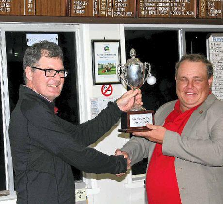 Dan Williams returns the Burnett Cup to Mundubbera club captain Peter Hunsley.