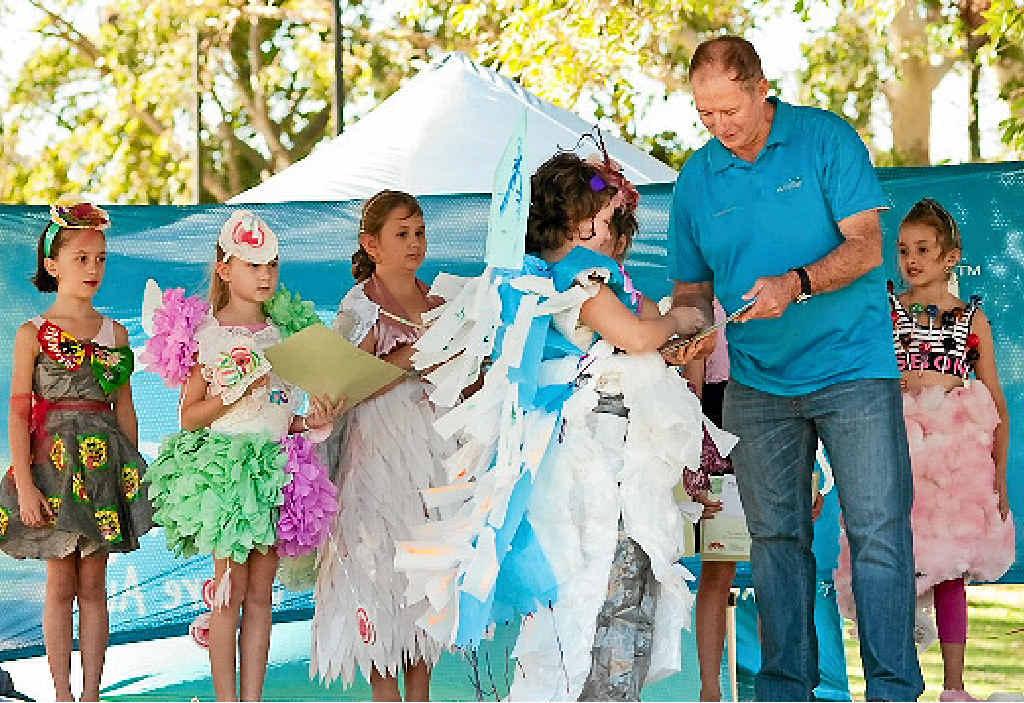 IMAGINATIVE: Participants from last year's Wilmar Sugar Wearable Art Parade with Wilmar's Danny Van der Berg.