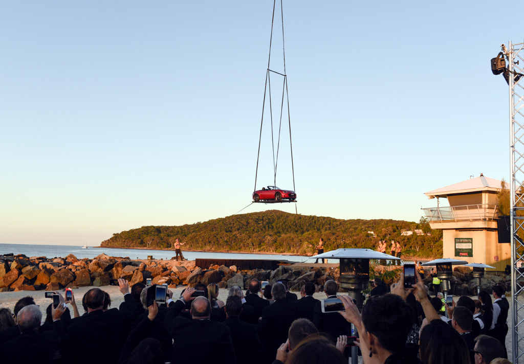 CROWD PLEASER: A helicopter lowered Mazda's new MX-5 roadster model onto Noosa's Main Beach yesterday as part of the Japanese car brand's #lookup campaign.