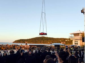 Sky-high car stunt creates Noosa beachside spectacle