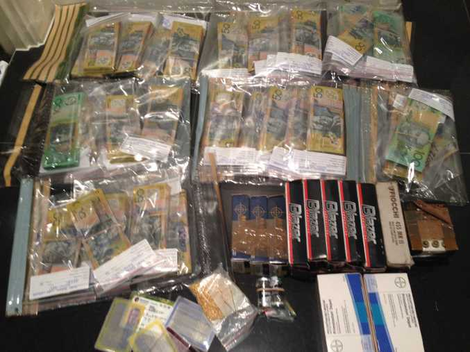 A sample of the drugs, fake licences and cash seized from a Gold Coast raid