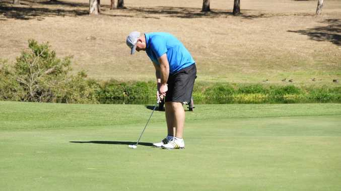 Anthony Boyd from Gladstone sinks an easy two foot putt on the 18th hole at the Calliope Golf Course. Photo Campbell Gellie / The Observer