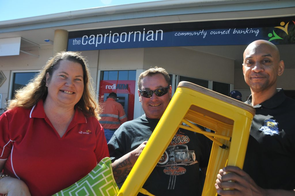 The Capricornian Gladstone branch manager Faith Hutchinson, $5000 furniture winner Lou Maday, and Derek Rucker, head coach of Port City Power.