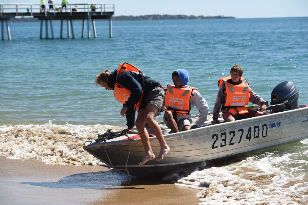 Urangan High year 11 marine aquatics students (L) Zak Brady, Dimitri Preister and Kyle Owen bring their tinnie into Torquay Beach. No better place to be on a winters day as they put some of their boating theory to practise. Photo: Alistair Brightman / Fraser Coast Chronicle