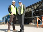 "Building are ""green"" library for Toowoomba are (from left) Hutchinson Builders area manager Robert Weymouth and Toowoomba region Mayor Paul Antonio."