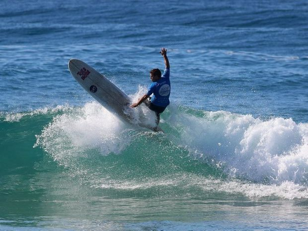 Emerald Beach surfer Paul Scholten enjoyed surfing on his home break during the opening round of the Open Longboard division of the bcu Australian Surf Festival.
