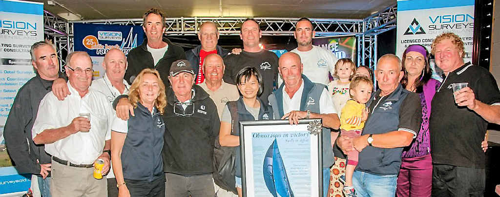 FOUNDING FATHER: Don Algie (centre right) with his family and crew members of Storm 2 at last year's Airlie Beach Race Week, where he was honoured as the founder of the event.