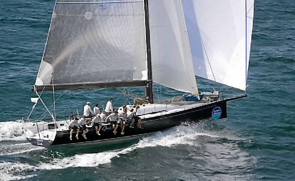 KEEN TO COMPETE: Pantaenius Australia CEO James MacPhail at the helm of Bob Steel's former TP52 Quest at Skandia Geelong Week, 2008.