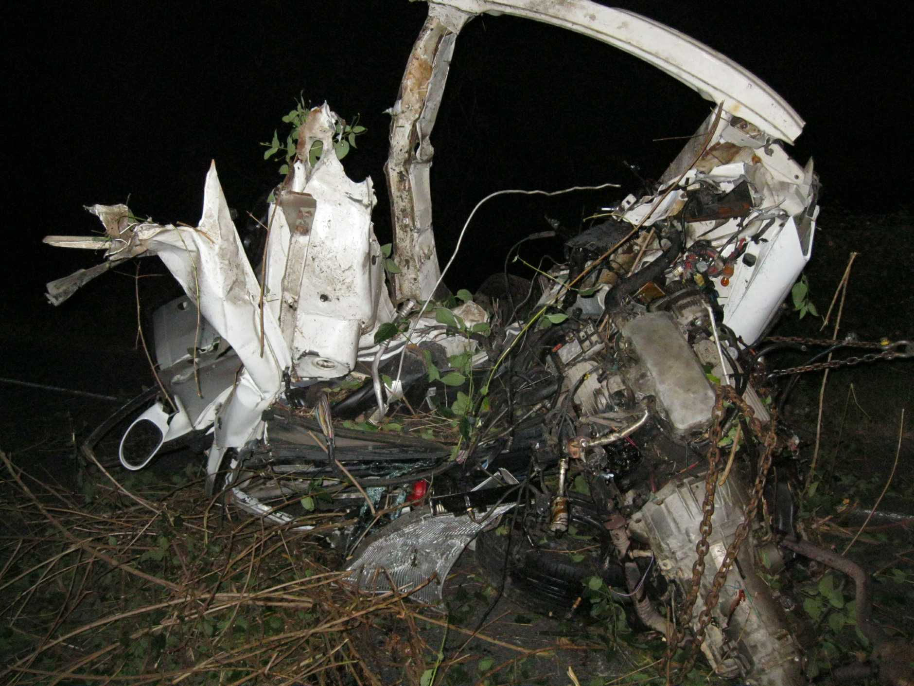 The wreck of a car that hit a tree after leaving the road at Cooroy.