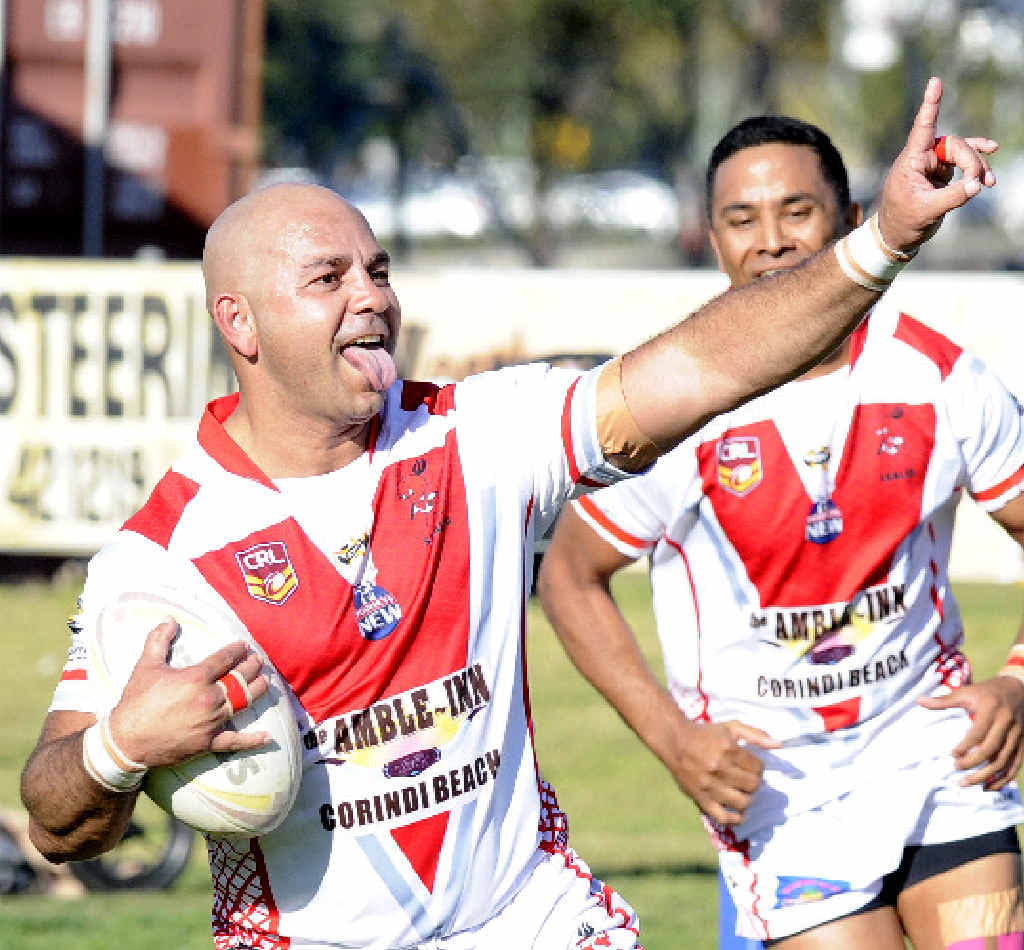 THIS ONE IS FOR YOU: South Grafton Rebels Chris Carr celebrates with the fans as he crosses for his first of two tries against the Coffs Harbour Comets.