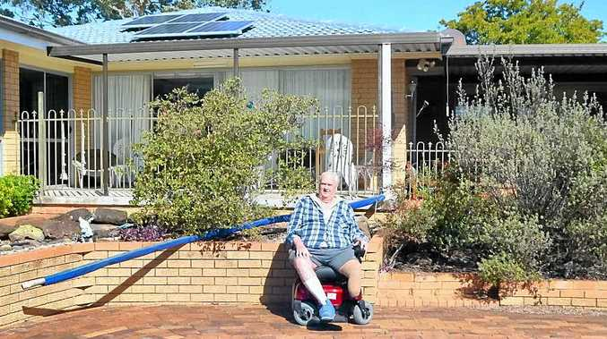 SOLAR SAVER: Kevin Toohill had solar panels installed as part of Origin Energy's solar scheme. There are no up-front costs and he expects to save $400 per bill.