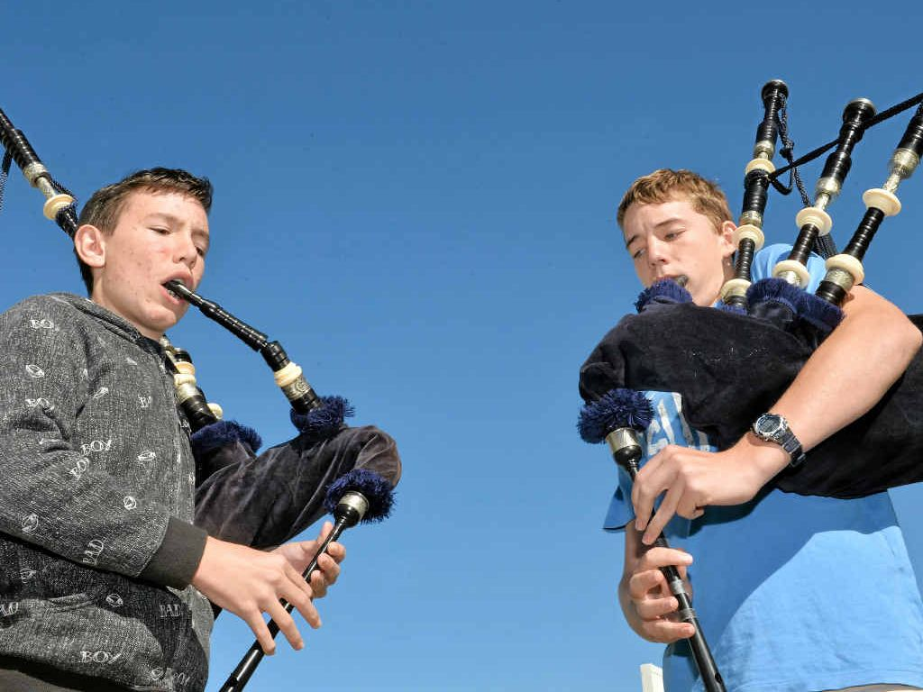 HIGHLAND NOTE: Aaron Gray and Oliver McCahill enjoy the fun of playing the bagpipes.