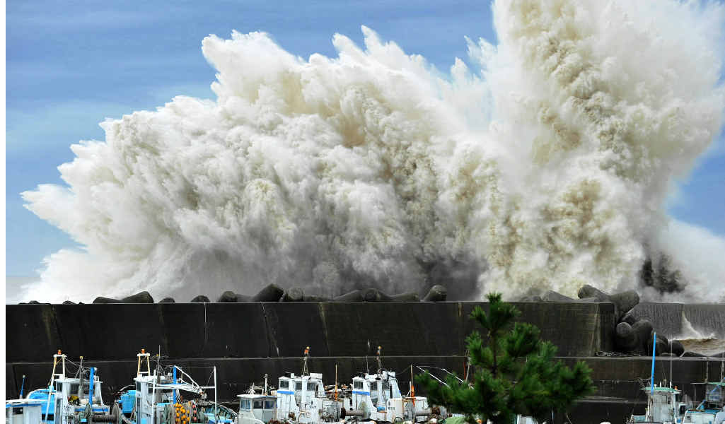 Surging waves hit against the breakwater in Udono in a port town of Kiho, Mie Prefecture, central Japan on September 21, 2011.