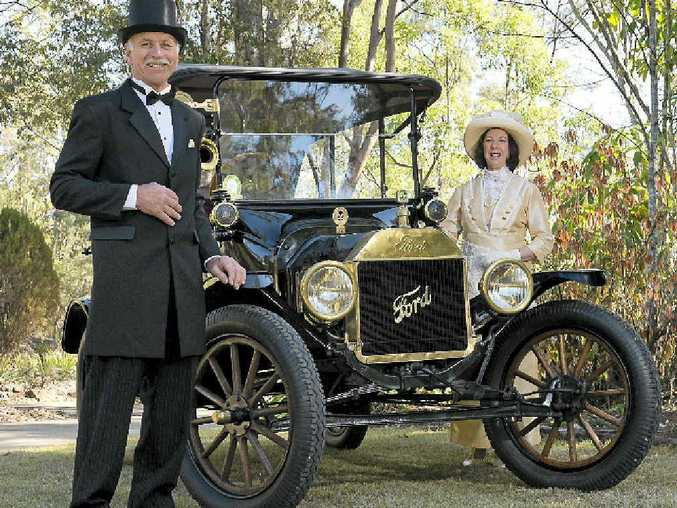IN SPIRIT: Len and Rosemary Kennedy have the period costumes to go with their Model-T Ford.
